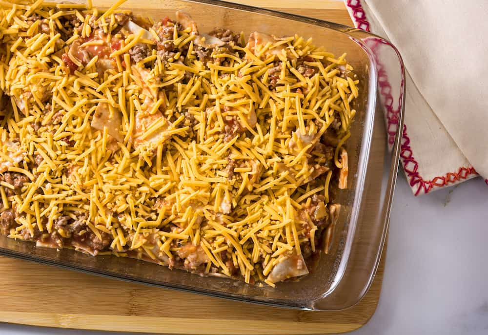 Make a dinner that wows with this taco bake casserole! It's so easy and your family will ask for it again and again. So cheesy and filling!