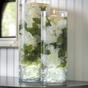 You can create these beautiful DIY wedding centerpieces in just a few steps. The submersible lights and flowers make them truly unique!