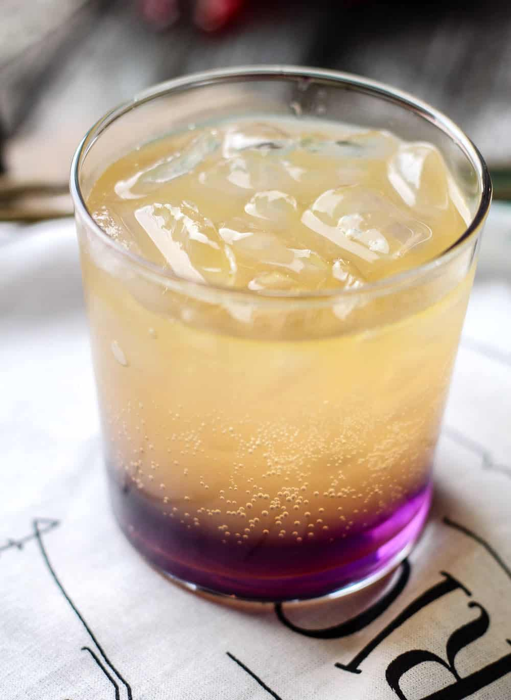 This hard lemonade recipe includes lavender syrup for a cocktail that both smells and tastes delicious! Learn how to mix it here.
