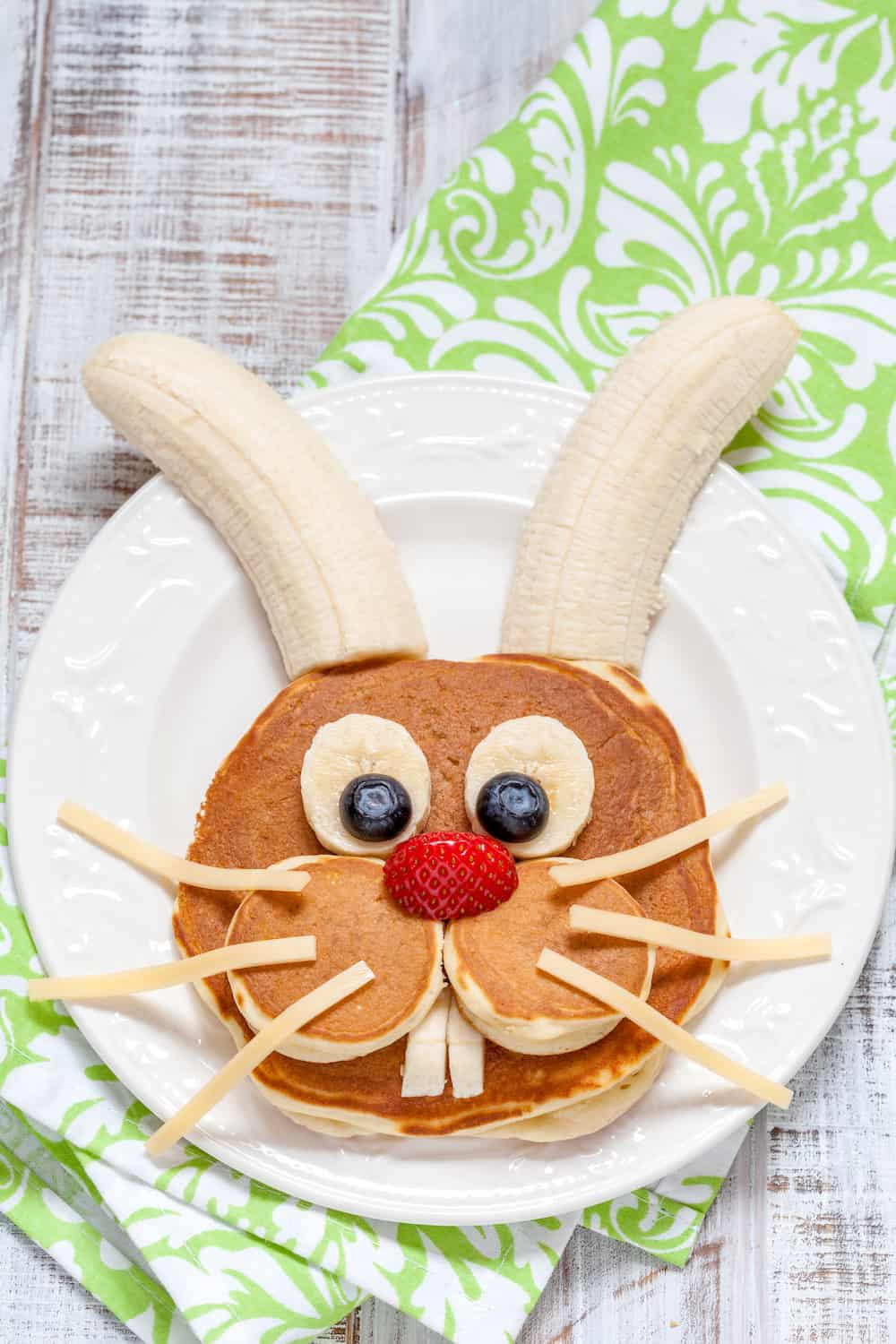Make your kids' holiday morning special with these Easter bunny pancakes. These are easy to make - you don't need to be a chef to do them!