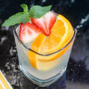 You'll love this delicious bittersweet white Sangria recipe - so refreshing! Instructions are provided for a both a single cocktail and a large batch.