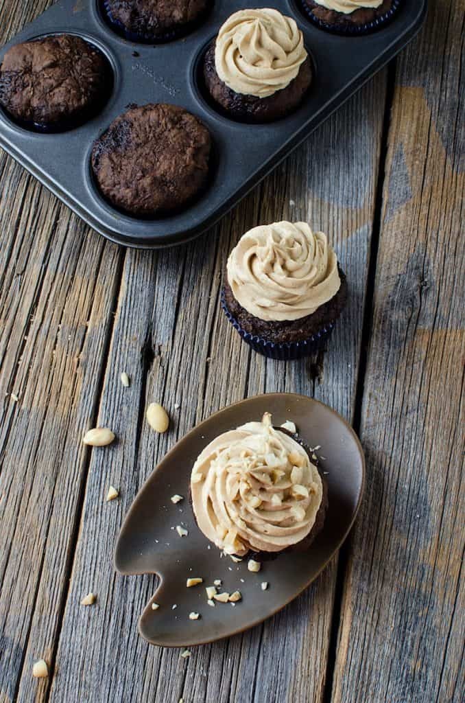 Peanut butter frosting on a cupcake on a modern dish on a wood background