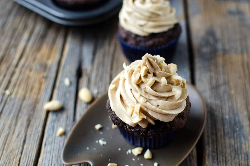 Chocolate zucchini muffins with peanut butter frosting