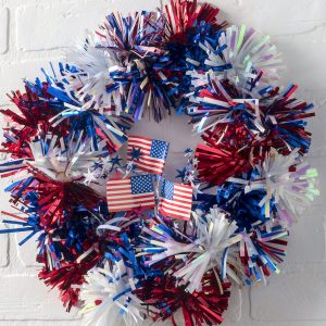 "Looking for patriotic inspiration? Make this ""firecracker"" themed Fourth of July wreath in 15 minutes flat! It's really easy and anyone can do it."