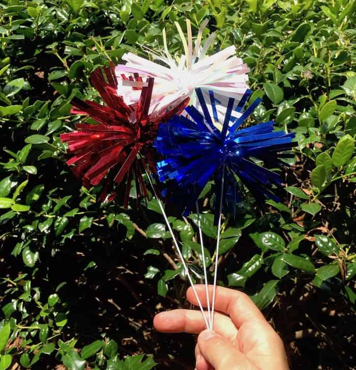 Red, white, and blue metallic pom pom sprays