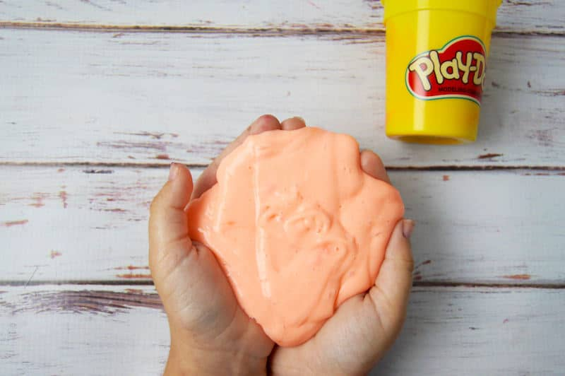 Making slime is SO fun! You can make this easy slime recipe with Play-Doh. It will keep the littles busy for hours. You'll love it!
