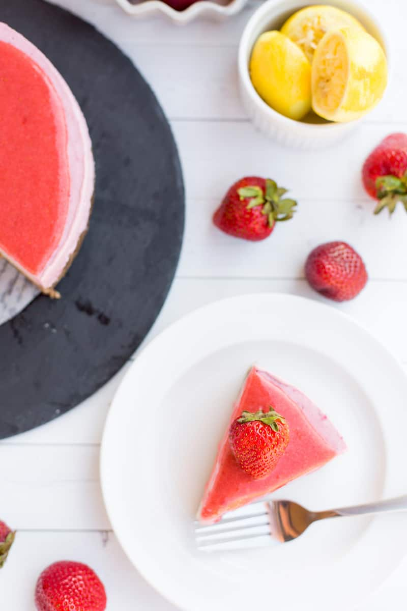 This no-bake layered strawberry lemon vegan cheesecake is beautiful and easy to make! Thick, creamy, and sweet with a delicious chewy crust.