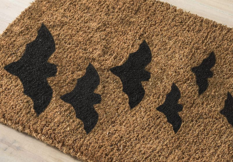 Welcome mats are so fun for the holidays! Make a simple and fun DIY Halloween doormat for your home with spray paint. Templates provided.