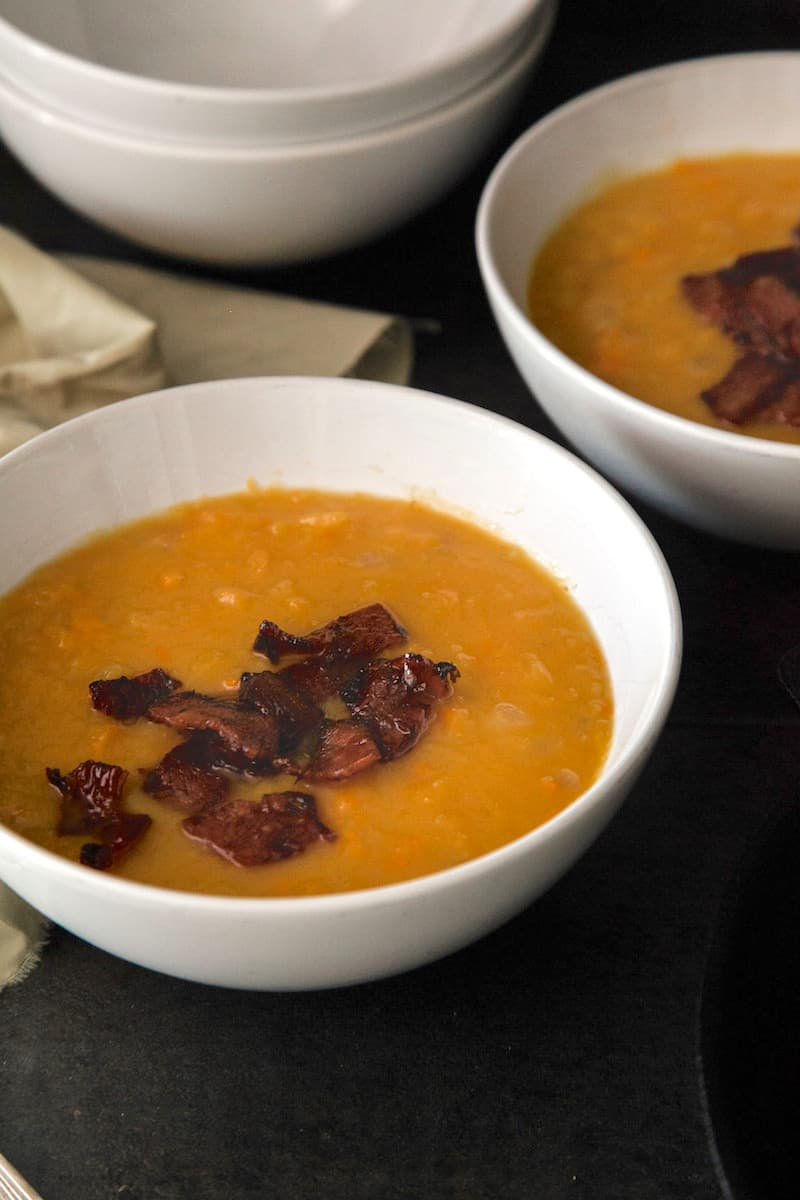When the nights are cool, you're going to turn to this sweet potato and squash bisque for comfort. Delicious bacon on top makes the recipe complete!