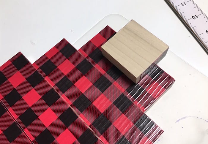 Use scrap 2 x 4s to make this small wooden Christmas tree! Add your favorite Duck Tape pattern - we personally love the buffalo plaid. Such a festive and inexpensive holiday decor idea!