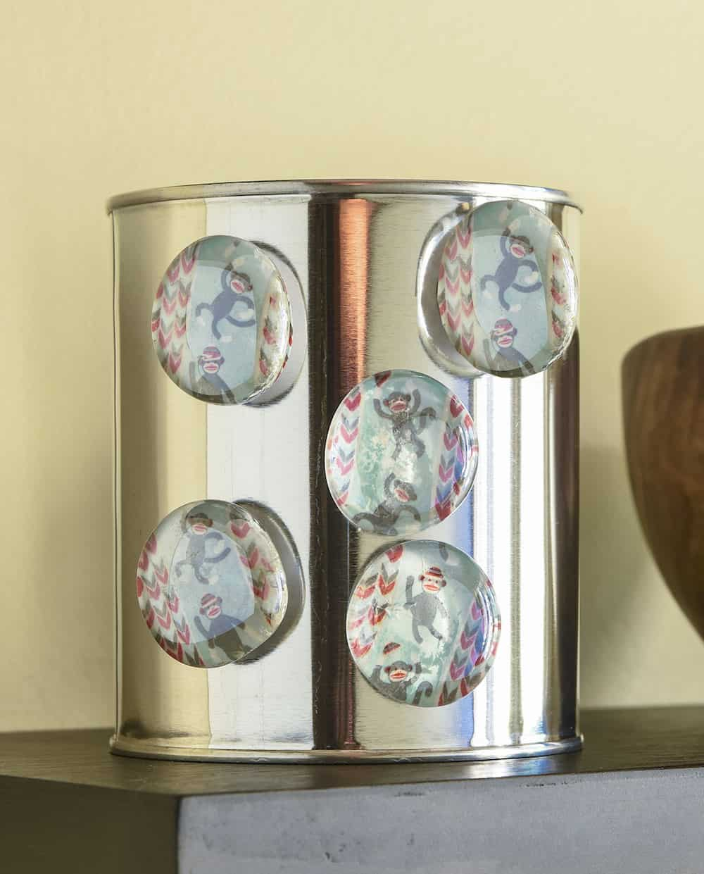 Learn how to make these easy personalized magnets using washi tape, flat glass marbles, and spray adhesive. You can make a ton of these for gifts or for your own fridge using a few simple supplies!