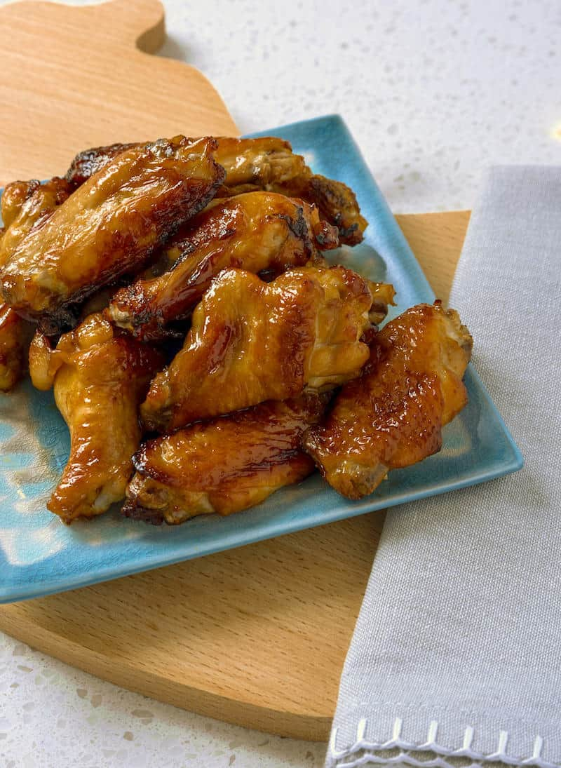 Want to know the secret to great Air Fryer chicken wings? I've got the recipe right here - with two variations for marinading sauces.