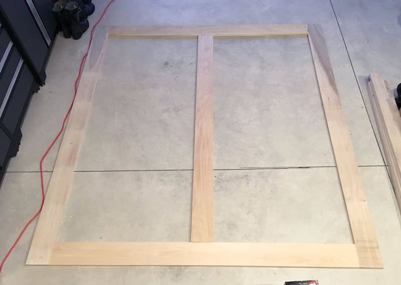 Step 2 modern DIY platform bed frame - laying out middle layer of frame