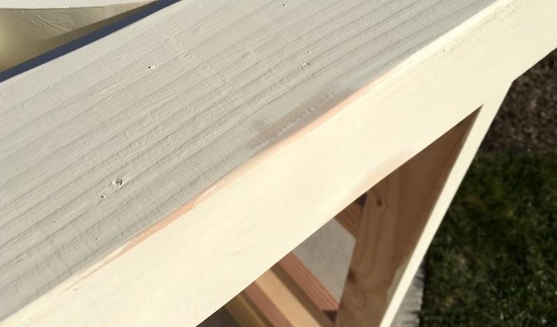 Distressing a farmhouse DIY coffee table