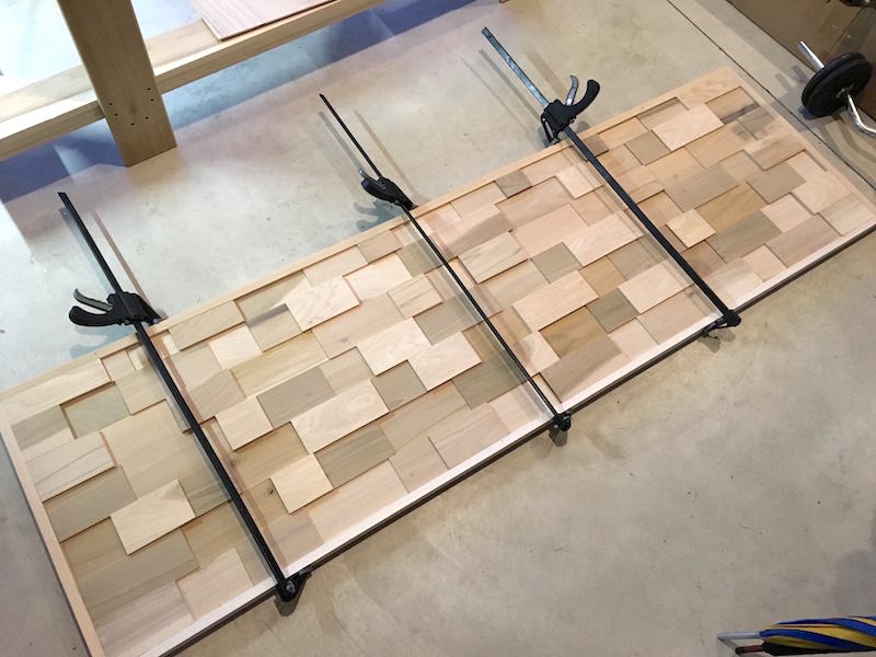 Mid century modern DIY wood headboard being glued
