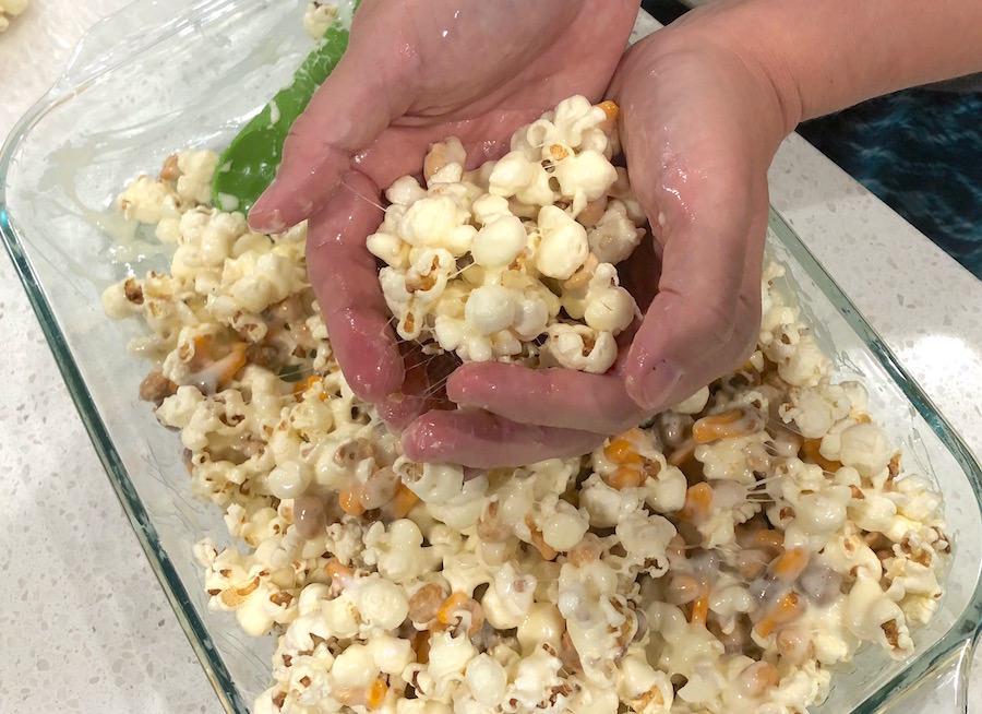 Forming the Halloween popcorn balls