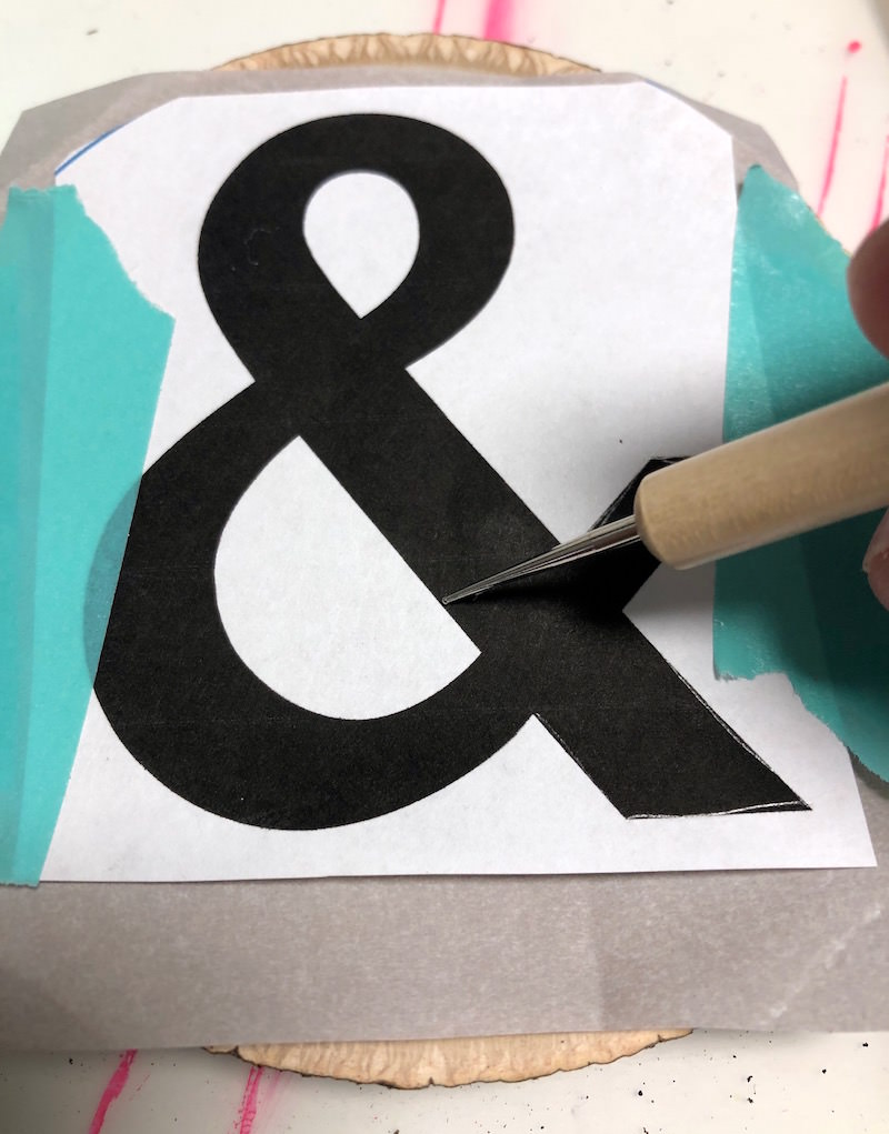 Using a stylus to trace an ampersand