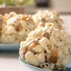 Easy Halloween Popcorn Balls Recipe (with Candy Corn!)