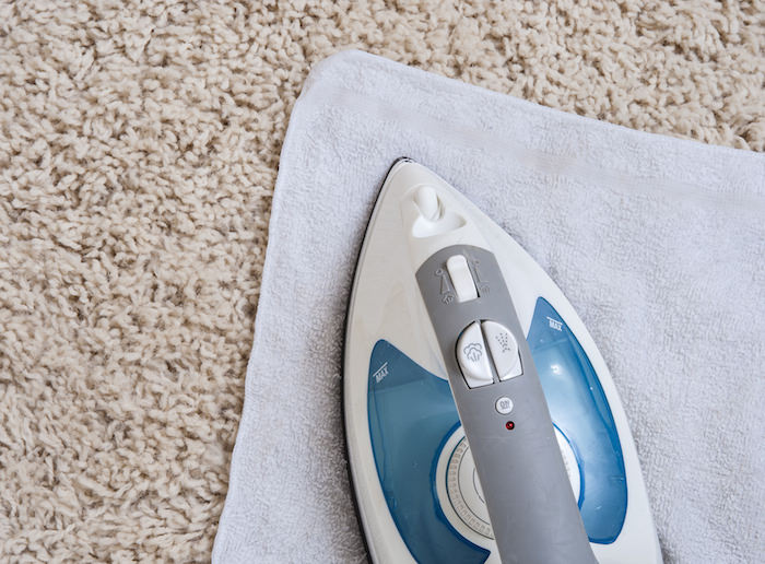 home cleaning tips - Remove Carpet Stains with an Iron