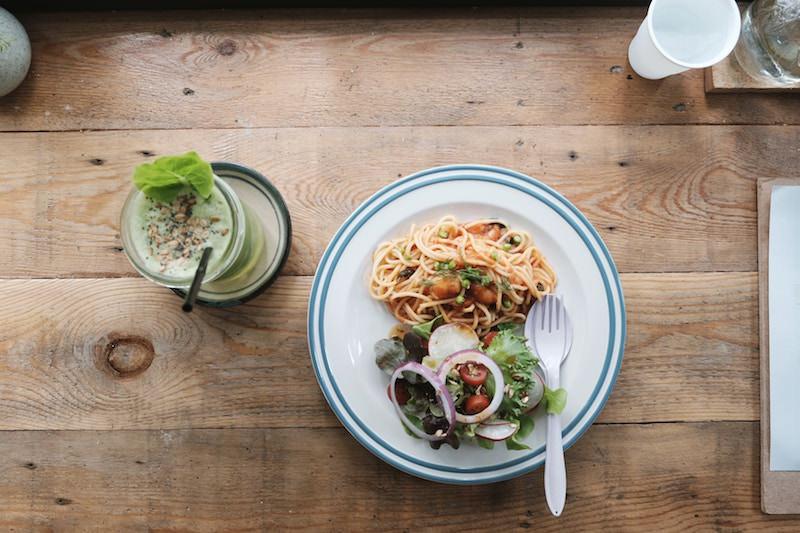 plate of pasta and a matcha shake