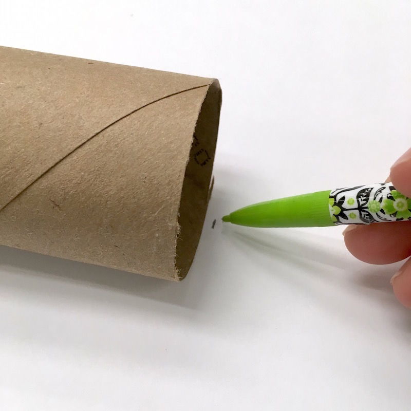 Trace a toilet paper roll on the back of paper with a pencil