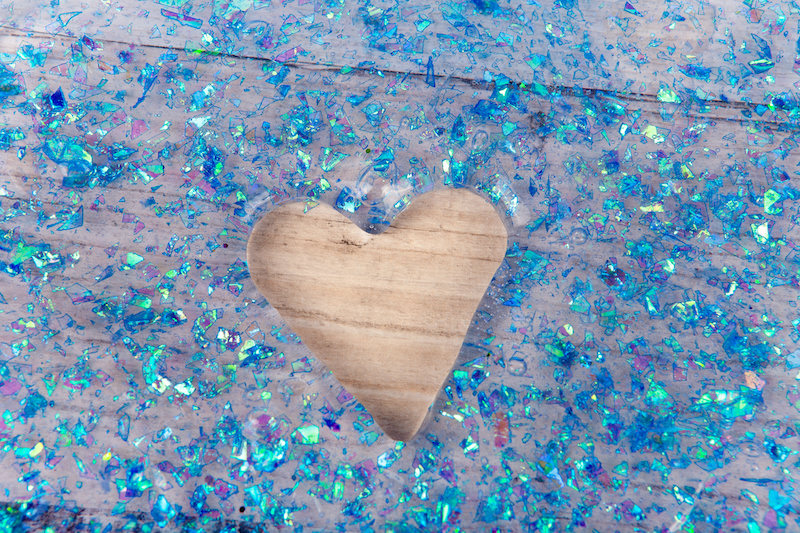 Blue confetti slime with a heart cut out of the center