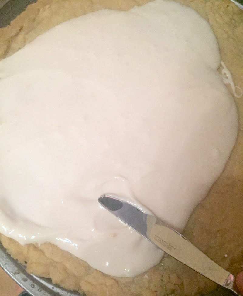 Spreading out frosting with a knife