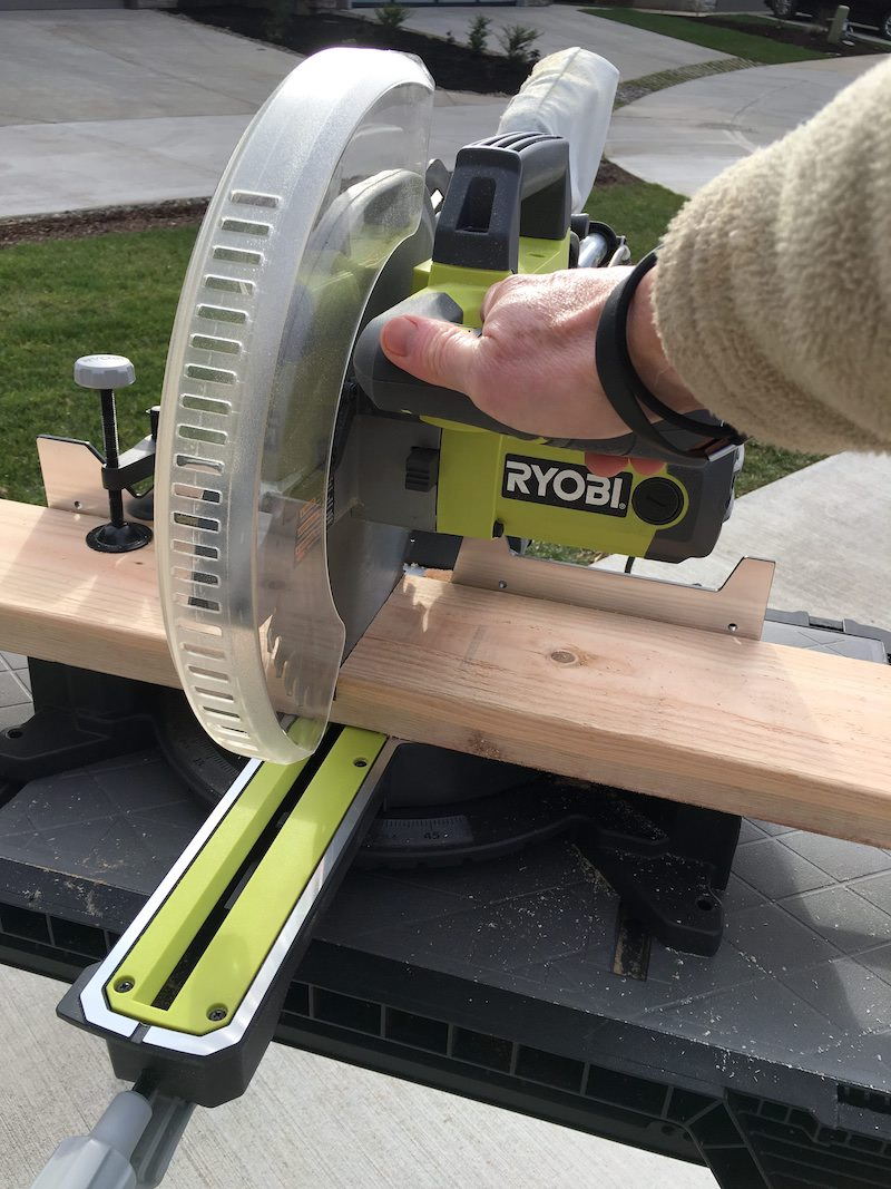 Cutting a wood  board with a Ryobi circular saw