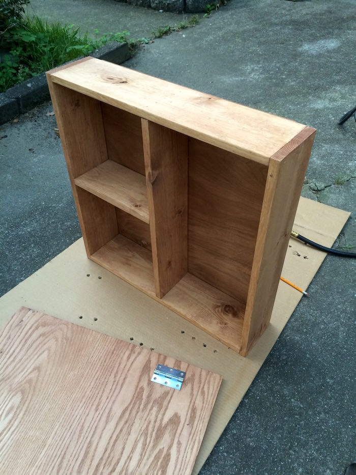 Finished wood shelf with dividers