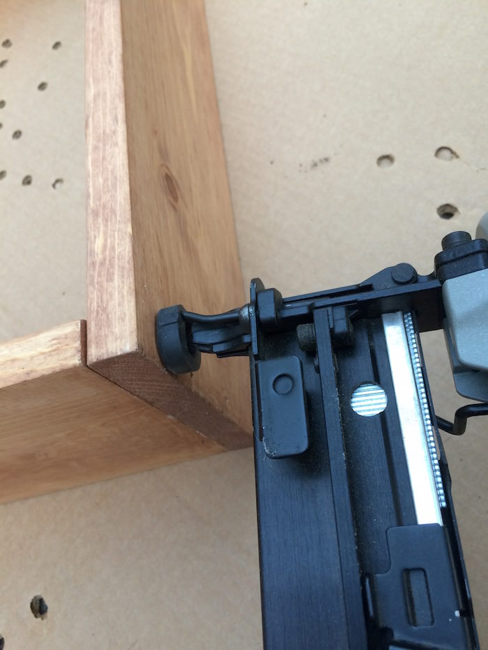 Nail gunning the side of wood box