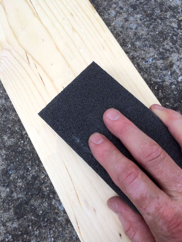 Sanding wood with a sanding block