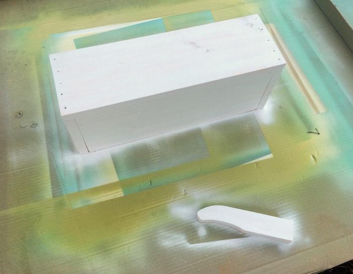 Spray primer on a wood box