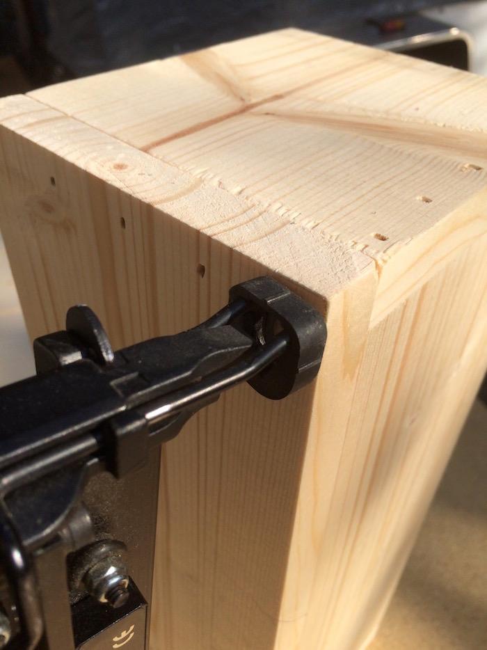Using a staple gun to attach the box