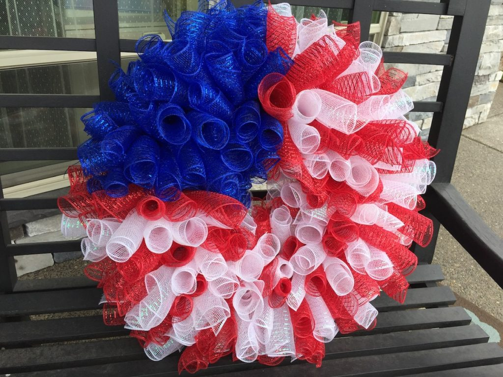 4th-of-July-mesh-wreath-sitting-on-a-bench