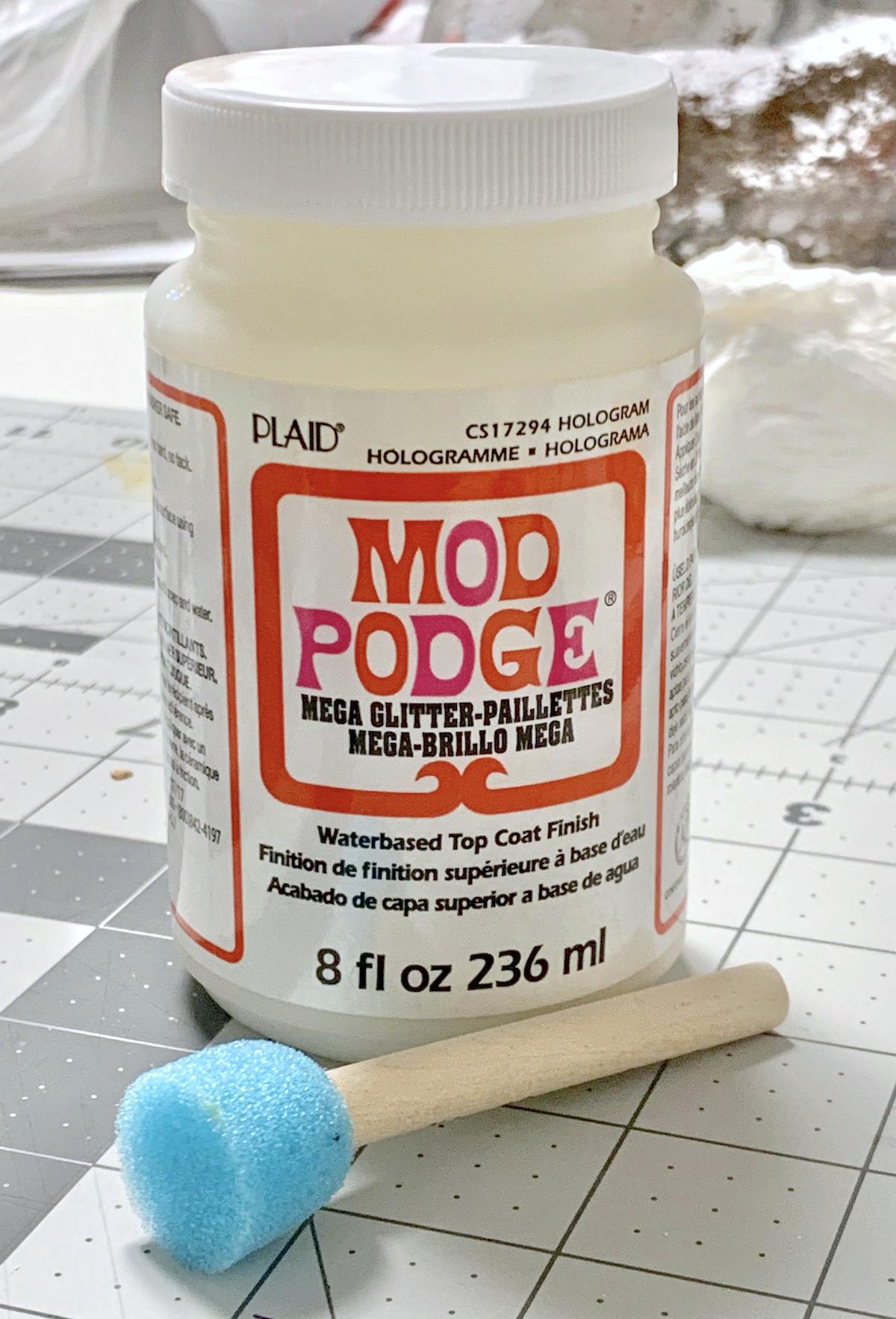 A bottle of Mega Glitter Mod Podge with a spouncer