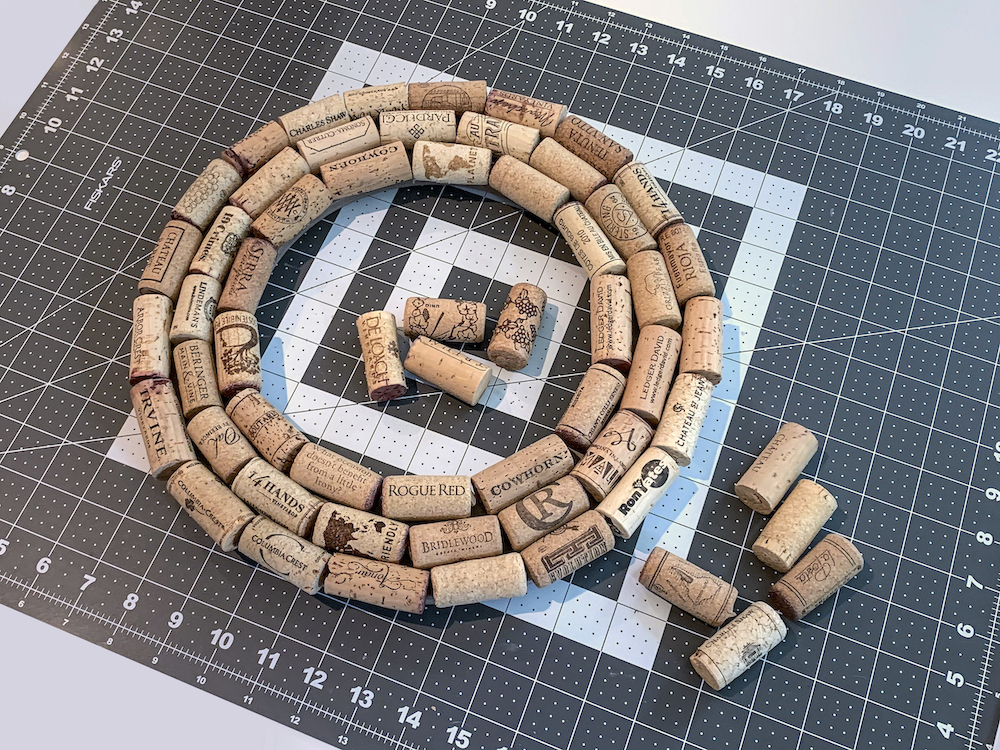 Three-rows-of-corks-on-a-wreath-form
