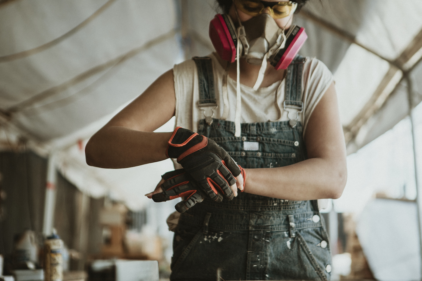 Female carpenter wearing personal protective equipment