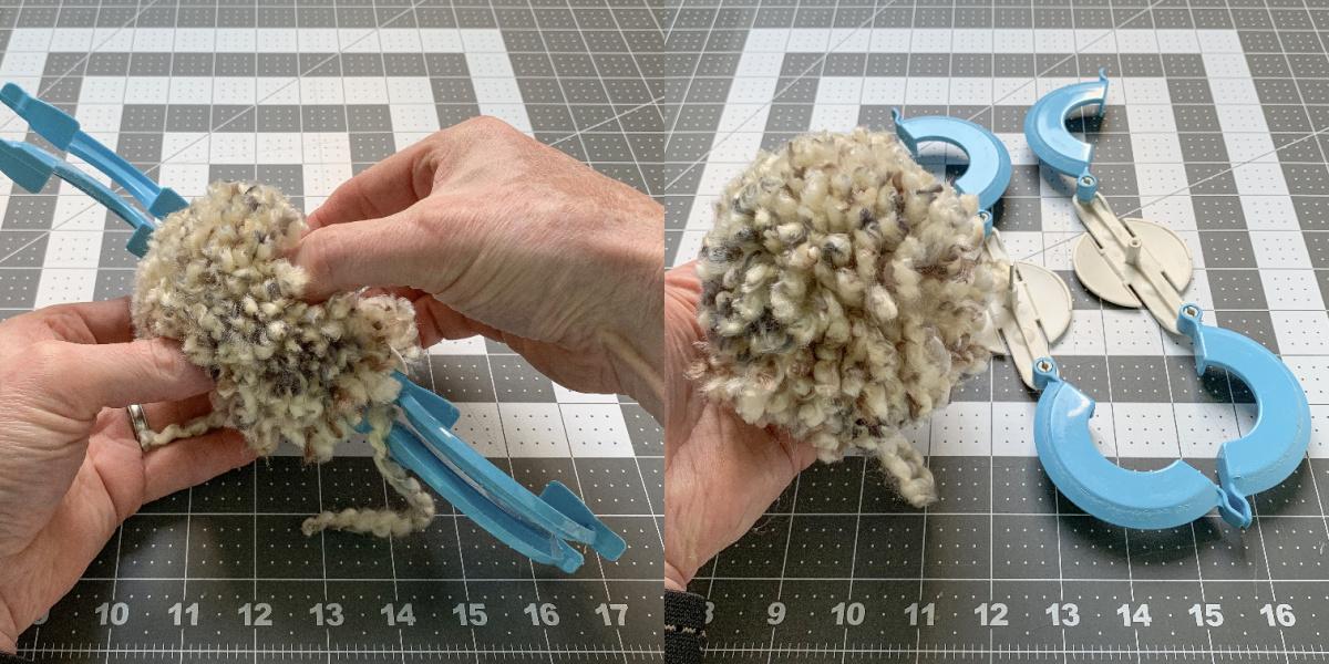 Hands opening a pom pom maker to remove the finished pom pom