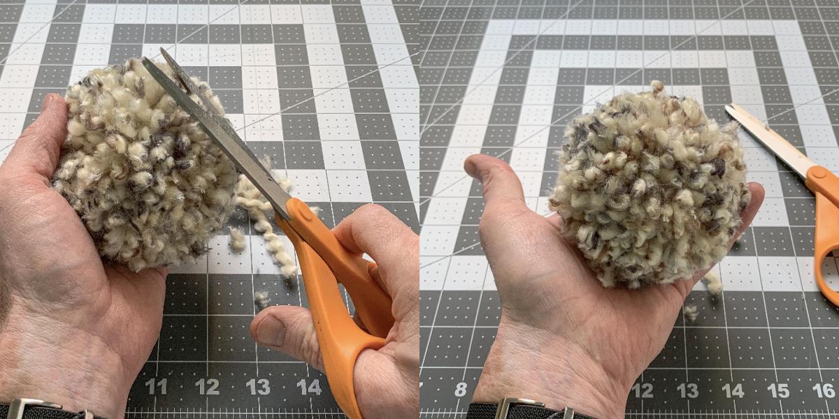 Trimming yarn off of a pom pom with scissors