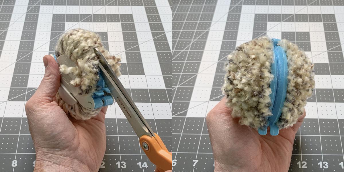 Using scissors to cut the yarn on a pom pom maker