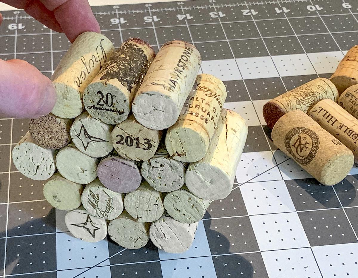 Creating a pumpkin shape by gluing wine corks