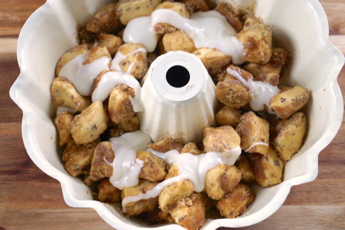 Glaze drizzed on top of pumpkin monkey bread pieces