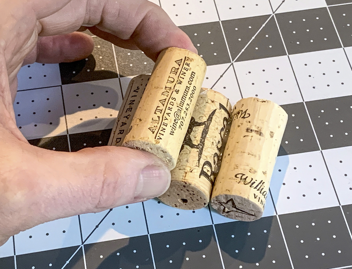 Hot gluing rows of wine corks on top of each other
