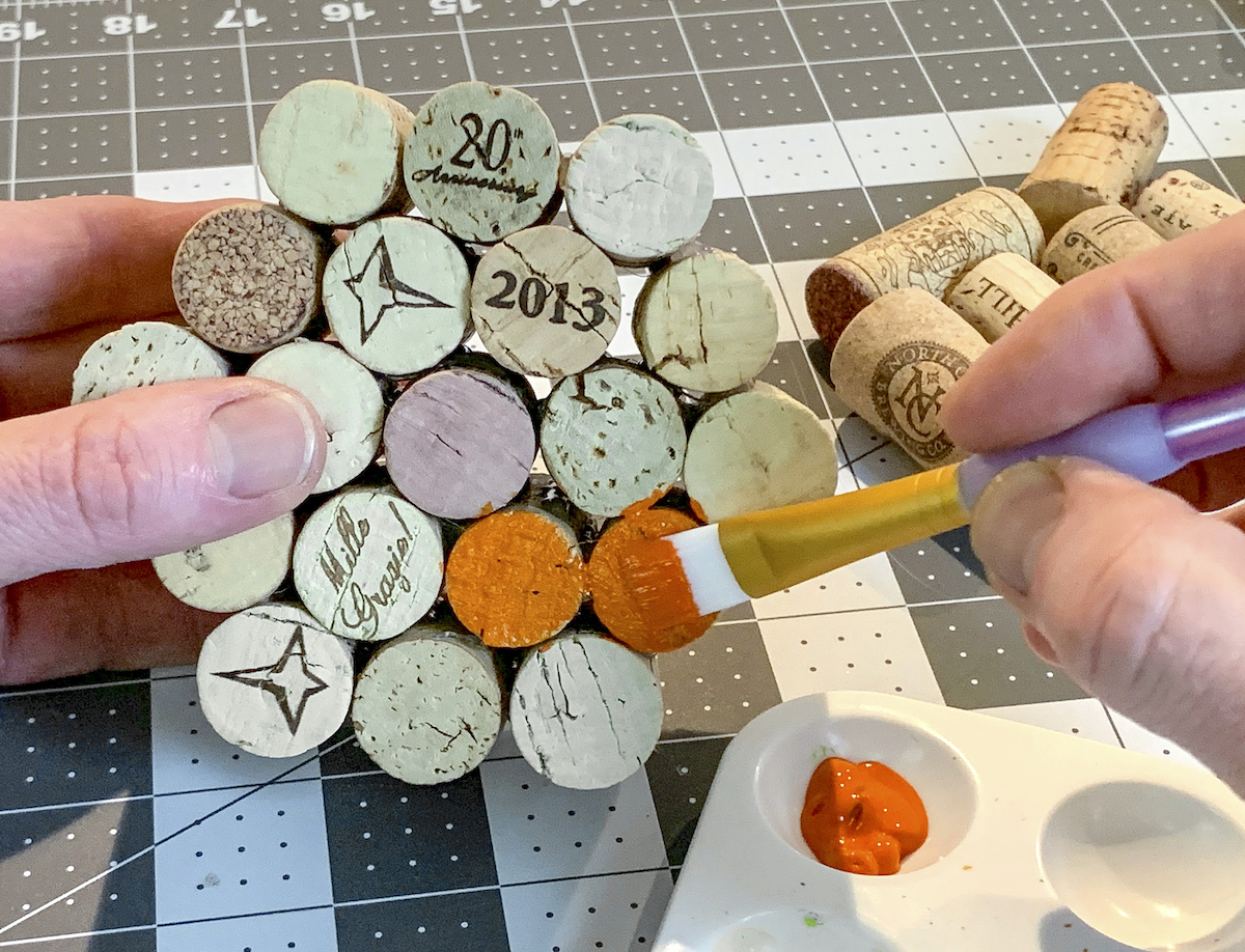 Painting the ends of the cork with acrylic paint