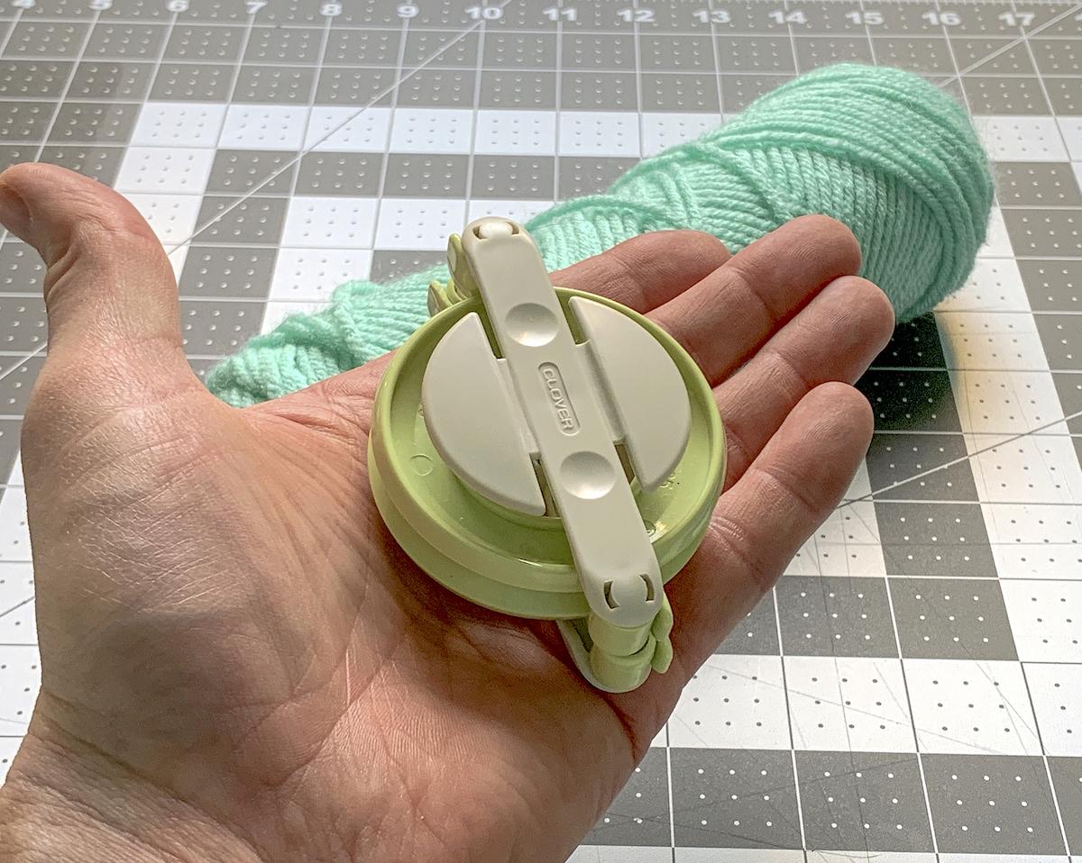 Pom Pom maker in a hand