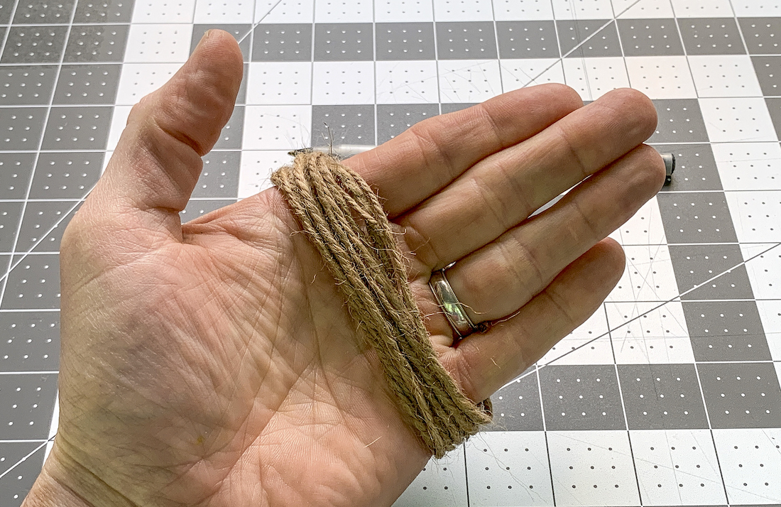 Twine looped around an adult hand