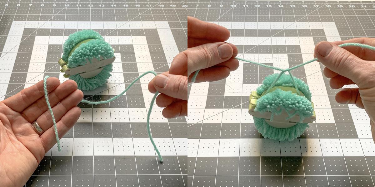 Tying yarn around the center of a pom pom to secure
