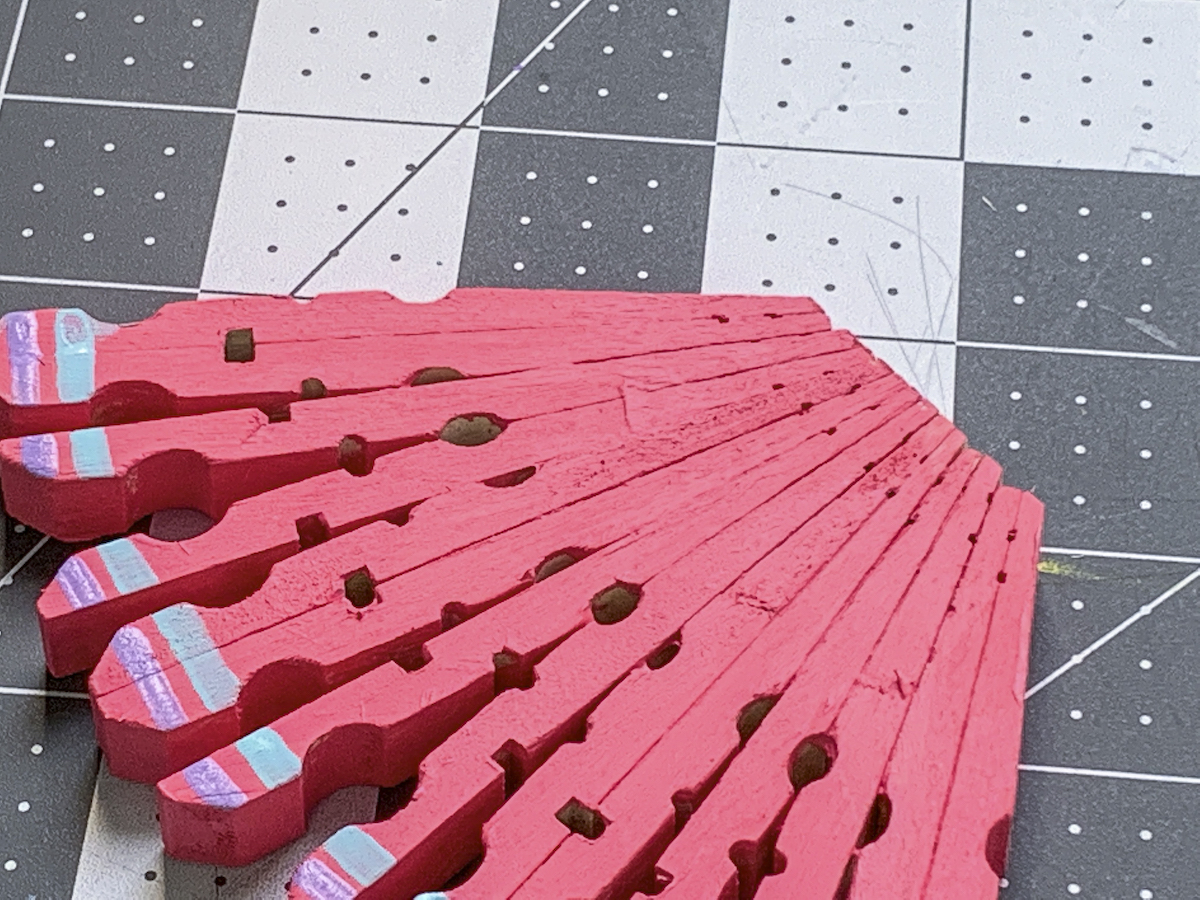 Butterfly wing made out of clothespins and painted pink