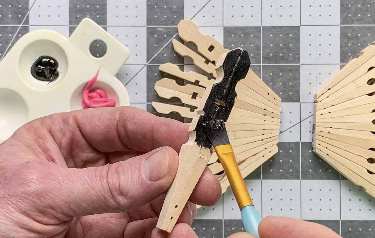 Painting clothespins with black acrylic paint