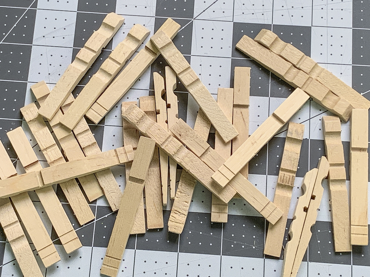 Pile of wooden clothespins with no springs